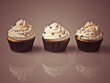 Cream Cupcakes on Coffee Background